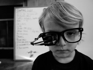 Ebeling's son wearing a prototype of the Eyewriter